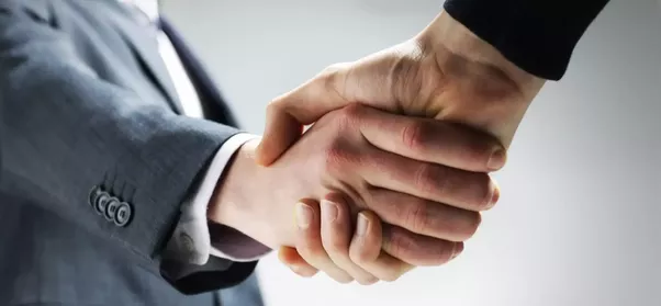 Business leaders shaking hands
